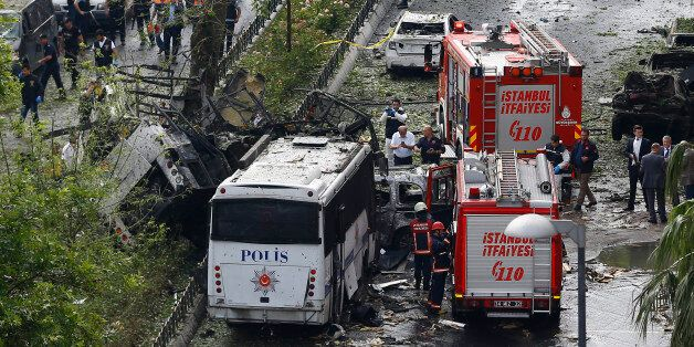 Fire engines stand beside a Turkish police bus which was targeted in a bomb attack in a central Istanbul...