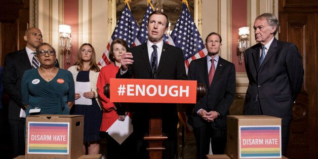 Sen. Chris Murphy, D-Conn., center, and other Democratic senators call for gun control legislation in...