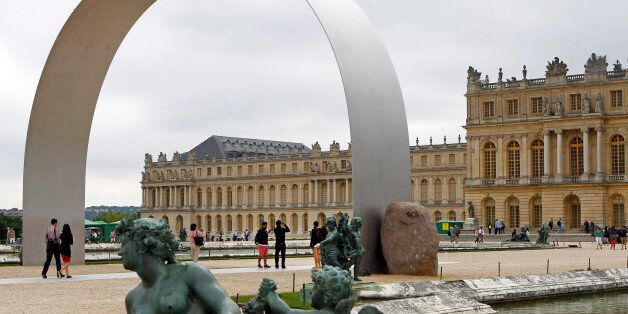Visitors walk under The Arch of Versailles, a work of art by Korean artist Lee Ufan, displayed in the...