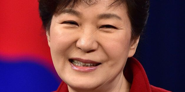 South Korean President Park Geun-hye smiles during her New Year's press conference at the presidential...