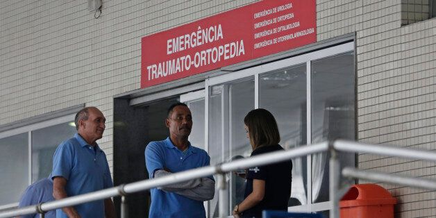 Employees stand in front an emergency entrance at the Souza Aguiar Hospital, in Rio de Janeiro, Brazil,...