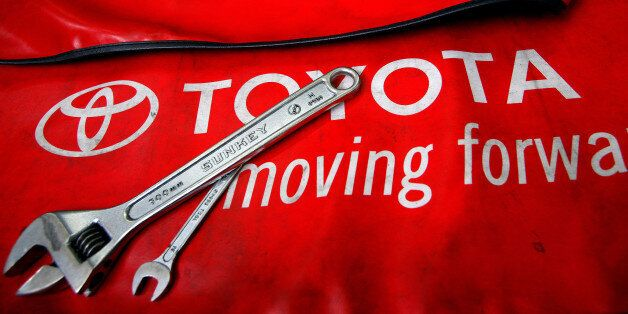 Spanners are placed on a mat by mechanics for the photographer inside a Toyota service centre in Taipei...