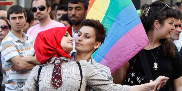 Participants dance during a gay pride parade in central Istanbul June 26, 2011. REUTERS/Murad Sezer (TURKEY...