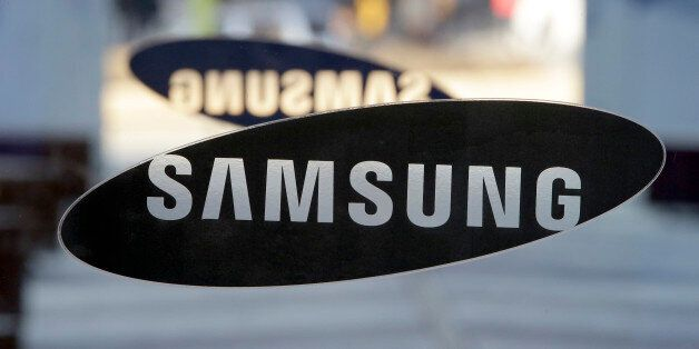 FILE-In this Jan. 8, 2015, file photo, a logo of Samsung Electronics is seen at its showroom in Seoul,...