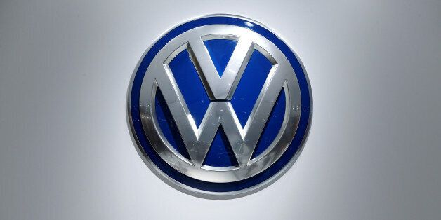 The logo of German car maker Volkswagen is pictured at the company's stand during the Hannover Fair in...