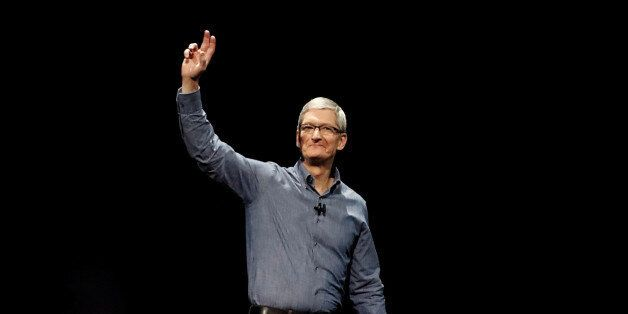 Apple Inc. CEO Tim Cook waves as he opens the company's World Wide Developers Conference in San Francisco,...