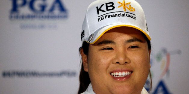 Inbee Park, of South Korea, begins to address a news conference after finishing the first round at the...