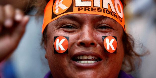 A woman wears a headband with the name of Peruvian presidential candidate Keiko Fujimori in Lima, Peru,...