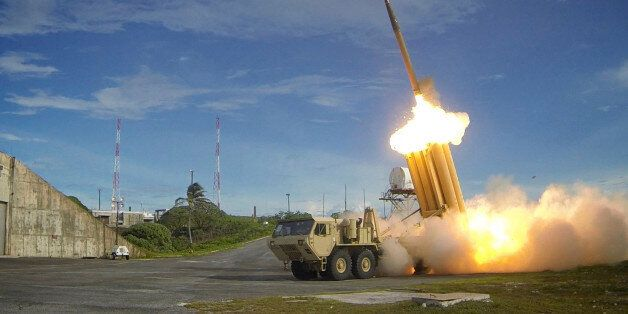 A Terminal High Altitude Area Defense (THAAD) interceptor is launched during a successful intercept test,...