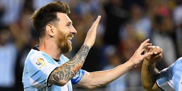 Jun 10, 2016; Chicago, IL, USA; Argentina midfielder Lionel Messi (10) reacts after three goals against...