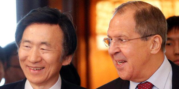 Russian Foreign Minister Sergei Lavrov (R) and his South Korean counterpart Yun Byung-se enter a hall...