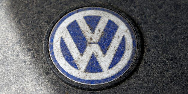 A Volkswagen (VW) logo is seen on a car engine at a scrapyard in Fuerstenfeldbruck, Germany, May 21,...