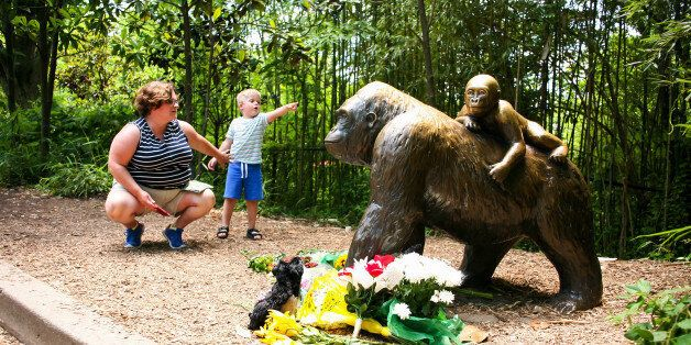 A mother and her child visit a bronze statue of a gorilla outside the Cincinnati Zoo's Gorilla World...