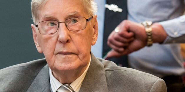 Defendant Reinhold Hanning, a 94-year-old former guard at Auschwitz death camp, sits in a courtroom before...