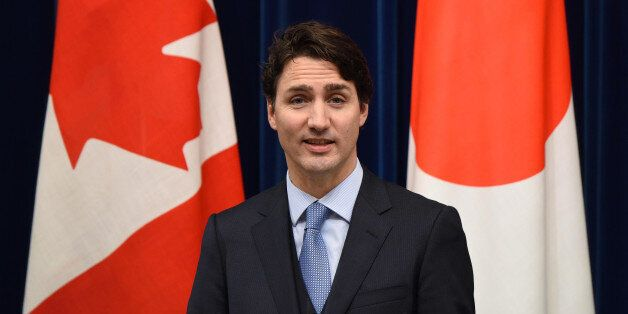 Canadian Prime Minister Justin Trudeau, left, speaks during a joint press conference with as his Japanese...