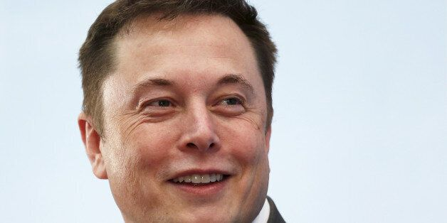 Tesla Chief Executive Elon Musk smiles as he attends a forum on startups in Hong Kong, China January...