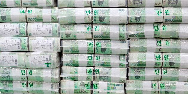 Bundles of South Korean money are stacked, ahead of their release, in the basement of the central bank...