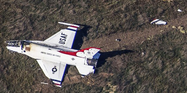 An Air Force F-16 with the Thunderbirds air demonstration squadron sits crashed in a field 4 miles south...