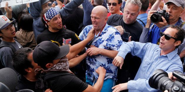 Trump supporters and anti-Trump demonstrators clash outside a campaign event for U.S. presidential candidate...