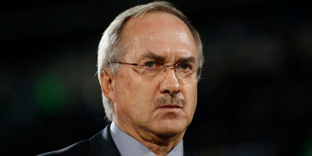 South Korea's head coach Uli Stielike looks on before a friendly soccer match against Paraguay at Cheonan...