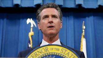 FILE -- In this July 23, 2019 file photo is California Gov. Gavin Newsom during a news conference in Sacramento, Calif. The Trump campaign and Republican Party have sued California over a new law requiring presidential candidates to release their tax returns. Newsom, who signed the law last week has been named as a defendant in one of the two lawsuits, filed Tuesday, Aug. 6, 2019. The suits argue the law is unconstitutional. (AP Photo/Rich Pedroncelli, File)