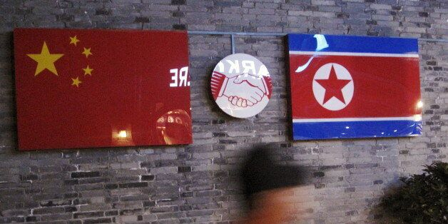 Flags of China and North Korea are seen outside the closed Ryugyong Korean Restaurant in Ningbo, Zhejiang...
