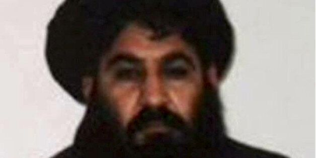 Taliban leader Mullah Akhtar Mohammad Mansour is seen in this undated handout photograph by the Taliban....