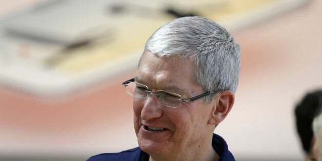 Apple CEO Tim Cook visits with customers at the Apple Store Thursday, March 31, 2016, in Palo Alto, Calif....