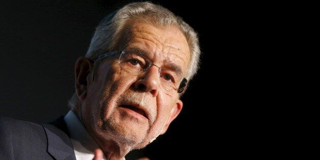 Alexander Van der Bellen supported by the Greens talks during his final election rally ahead of Austrian...