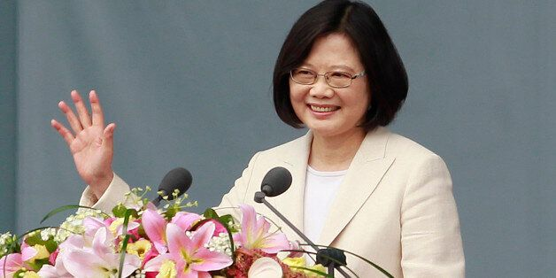 Taiwan's President Tsai Ing-wen waves to Taiwanese people as she delivers an acceptance speech during...