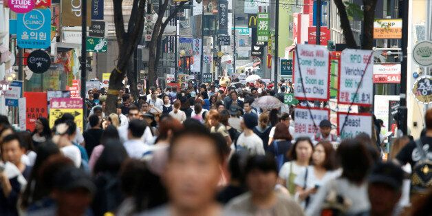 People walk in Myeongdong shopping district in Seoul, South Korea, May 31, 2016. REUTERS/Kim