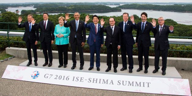 Japanese Prime Minister Shinzo Abe, center, waves with other leaders of Group of Seven industrial nations,...