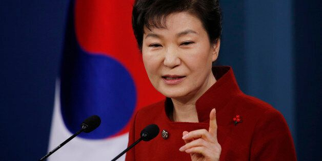 South Korean President Park Geun-hye answers to a reporter's question during her news conference at the...