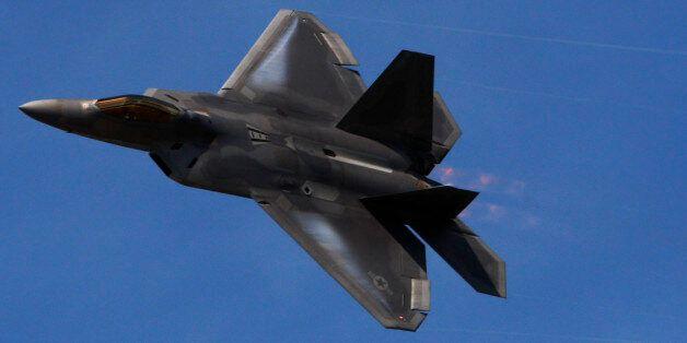 A F-22 flies in a display during Farnborough International Airshow, Farnborough, England, Monday, July...