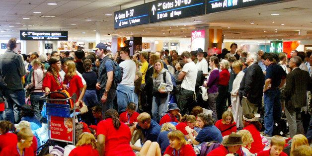 Hundreds of people wait outside the customs check point at Sydney international airport, Wednesday, July...