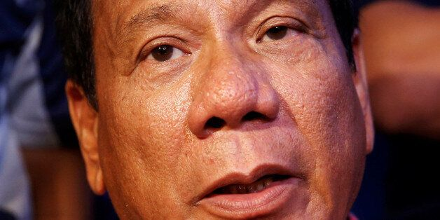 Presidential candidate Rodrigo 'Digong' Duterte speaks during a news conferece after voting in the national...
