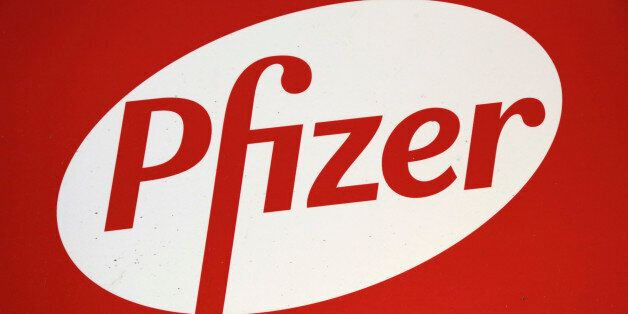 The Pfizer logo is displayed at world headquarters, Monday, Nov. 23, 2015 in New York. Pfizer and Allergan...