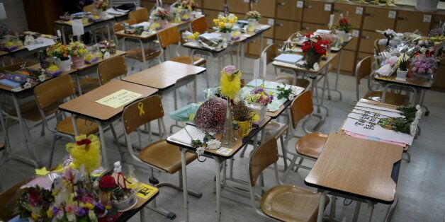 Desks used by victims who were onboard sunken ferry Sewol are seen at an empty classroom, which was preserved...