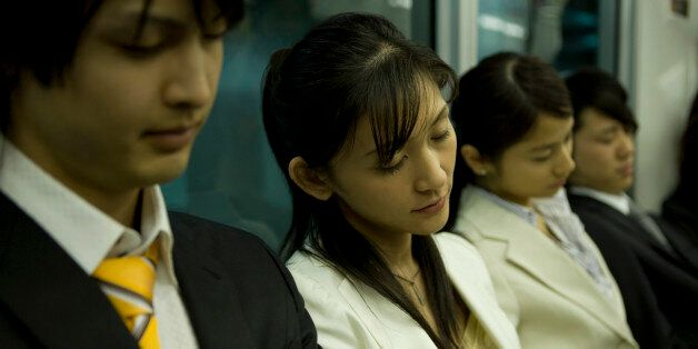People on the train, sleeping on the