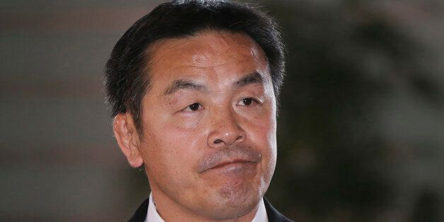 Japan's newly-named Minister of Education, Culture, Sports, Science and Technology Hiroshi Hase arrives...