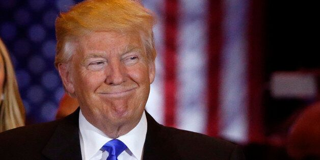 Republican U.S. presidential candidate Donald Trump smiles as he speaks at the start of a campaign victory...