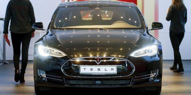 A Tesla car 'Model S' sits in a dealership in Berlin, Germany, November 18, 2015. REUTERS/Hannibal