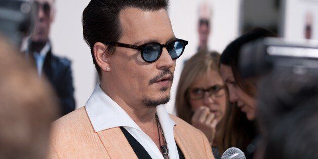 BROOKLINE, MA - SEPTEMBER 15: Actor Johnny Depp arrives on the red carpet for the Boston premiere of...