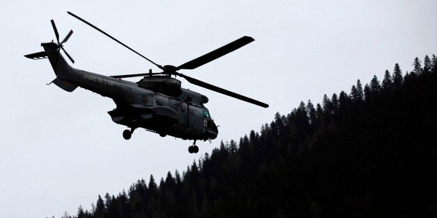 An helicopter flies over Seyne les Alpes, French Alps, Tuesday, March 24, 2015. A Germanwings passenger...