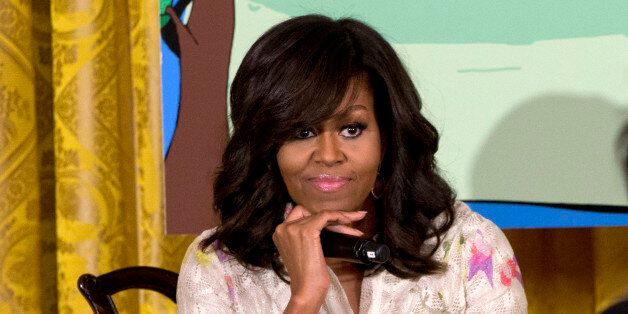 First lady Michelle Obama listens to a questions from a daughter of an Executive Office employee during...