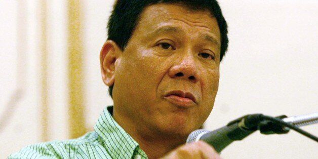Mayor Rodrigo Duterte of the city of Davao, gestures as he addresses the peace and order council meeting...
