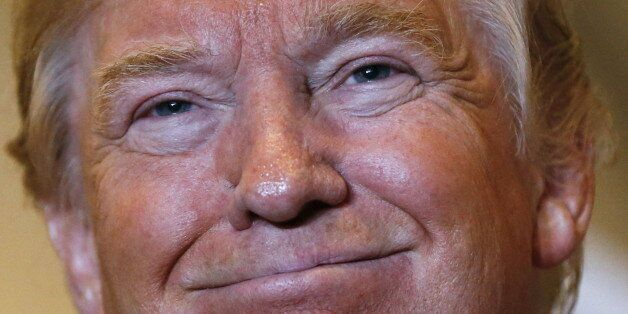 U.S. Republican presidential candidate Donald Trump smiles during a news conference to reveal his tax...