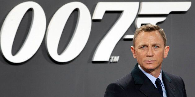 Actor Daniel Craig poses for the media as he arrives for the German premiere of the James Bond movie...