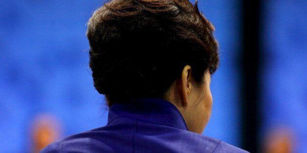 South Korea's President Park Geun-hye participates in the APEC Summit retreat session on regional economic...
