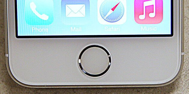 A close up view of the fingerprint scanner on the new Apple iPhone 5S is seen at a Verizon store in Orem,...